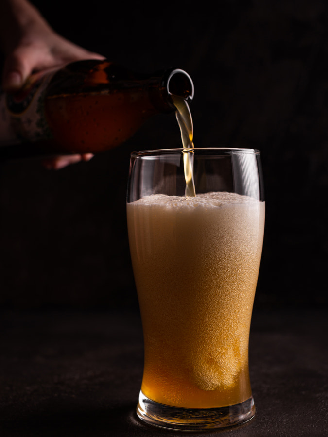 Beer is poured into a glass by Tati Honey on 500px.com