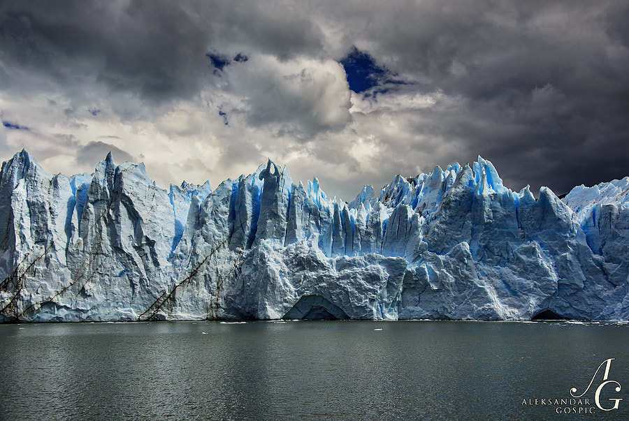Three aggregate states of water in sight as you approach 60m high head-wall of legendary Perito Moreno glacier over the waters of Lago Argentino in Patagonia, Argentina