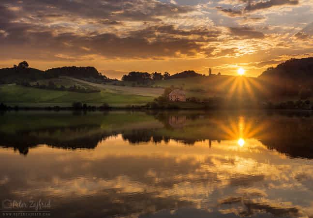 Reflected sunrise by Peter Zajfrid
