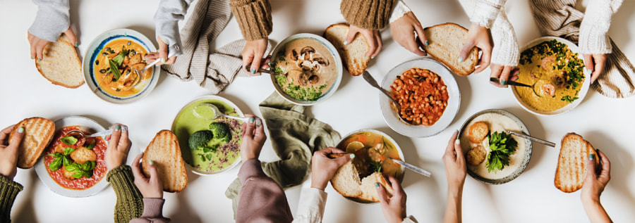 People eating various Autumn and Winter creamy vegan soups together by Anna Ivanova on 500px.com
