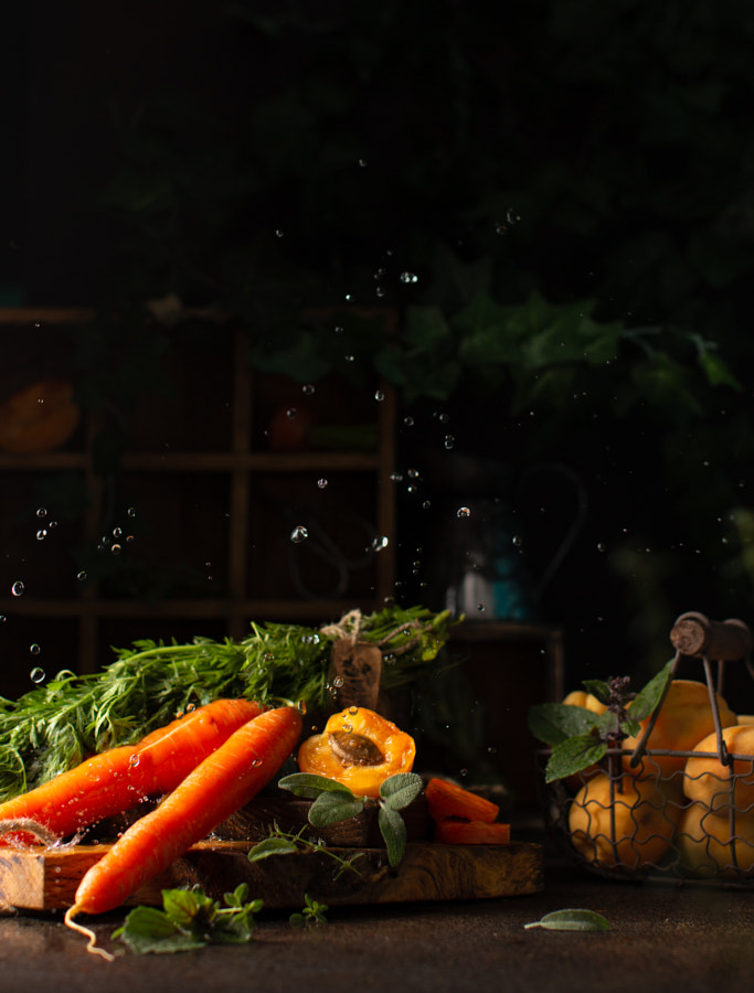Raw carrots and apricots with different healthy herbs on wooden by Olga on 500px.com