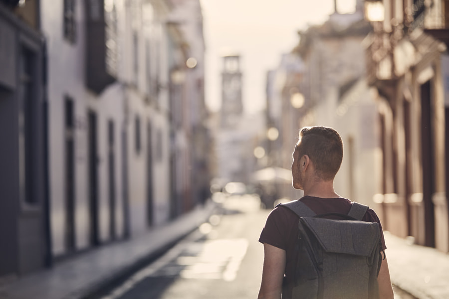 Traveler with backpack on street of old town by Jaromír Chalabala on 500px.com