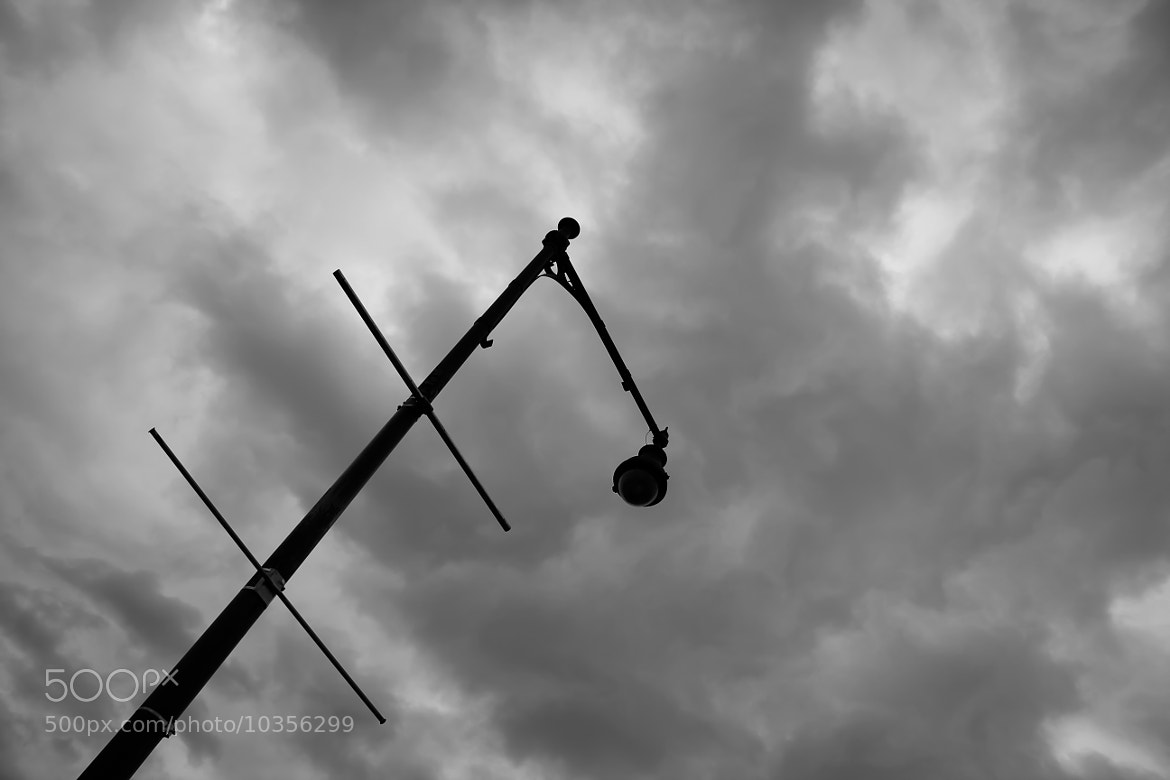 Photograph A lonely light pole under dense clouds by Visharad Deo on 500px