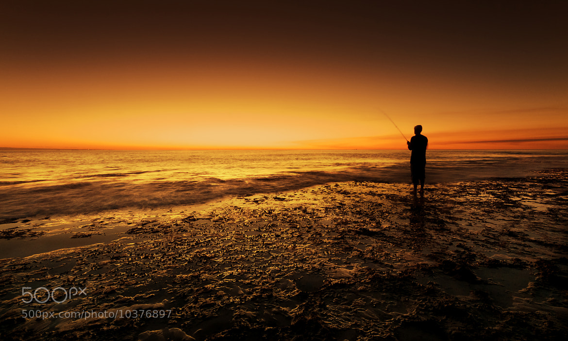 Photograph Lone Fisherman by Heather Thorning on 500px