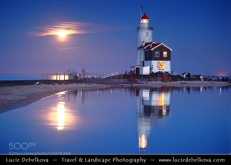 Photograph Netherlands - IJsselmeer - Giant Moon Rise over Marken Lighthouse on peninsula in IJsselmeer by Lucie Debelkova -  Travel Photography - www.luciedebelkova.com on 500px