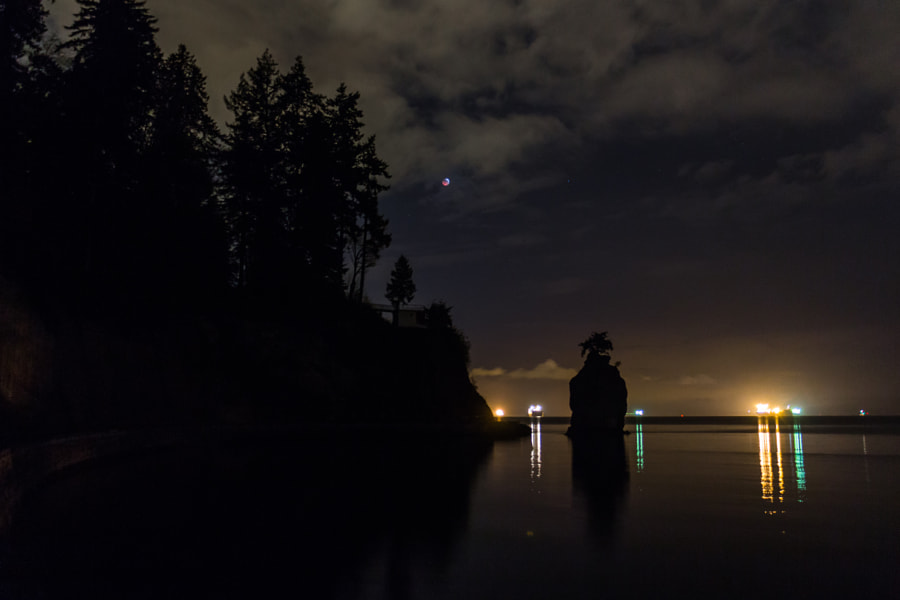 Photograph Eclipse at Siwash Rock by Chris Voth on 500px