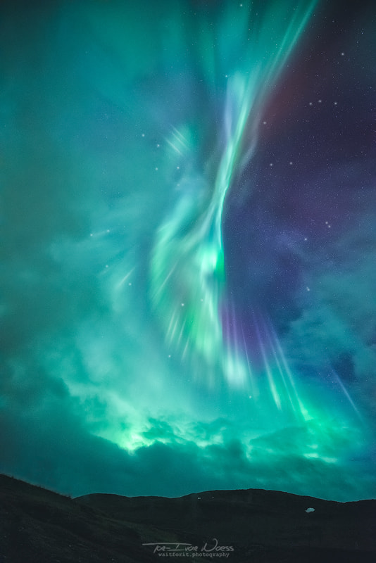 Clouds vs Aurorae by Tor-Ivar Næss on 500px.com