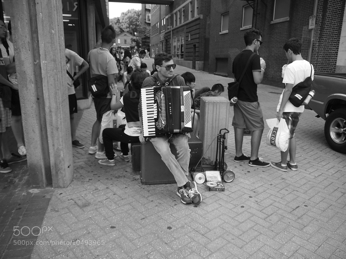 Photograph Street Performer taking a break by J S on 500px