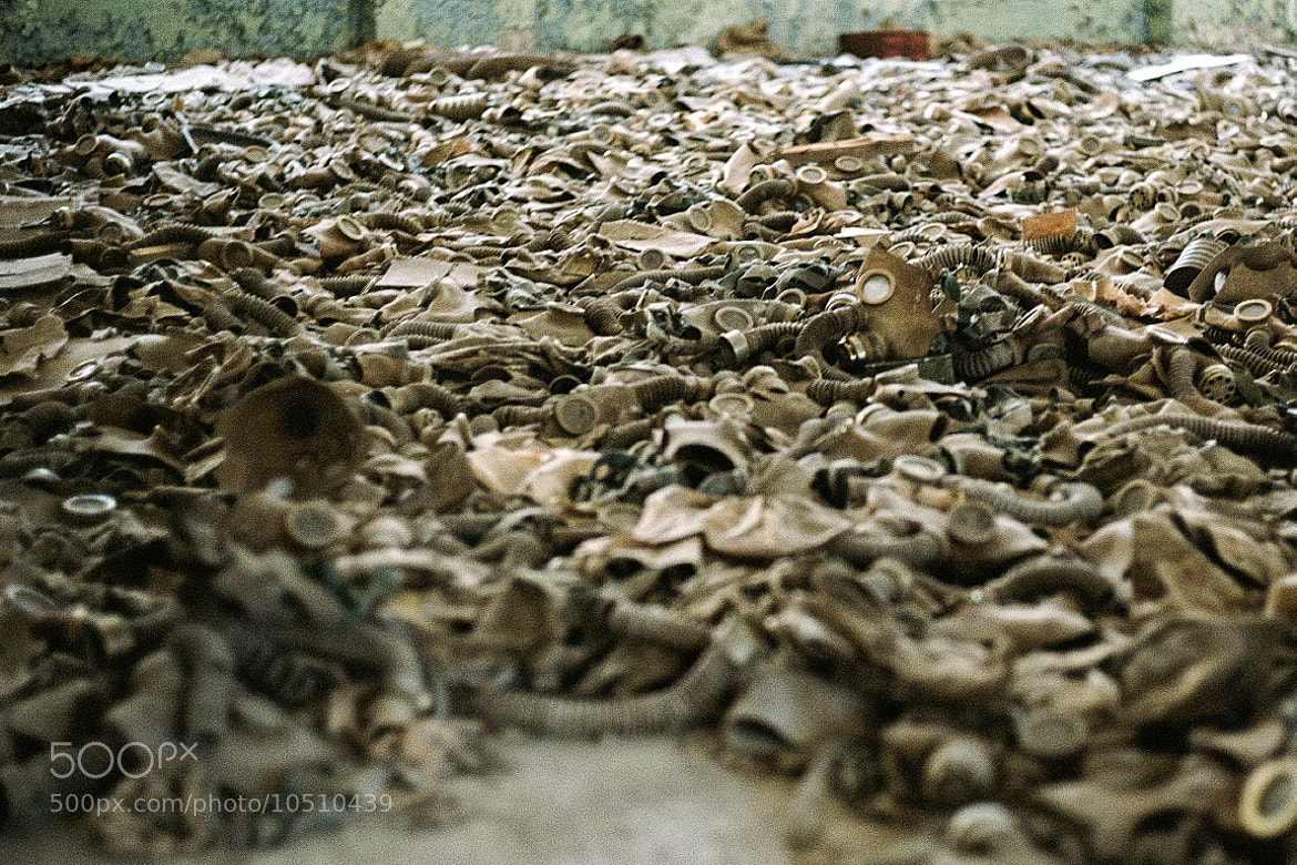 Photograph Discarded Gas Masks - Pripyat, Ukraine by Clemens Pierer on 500px