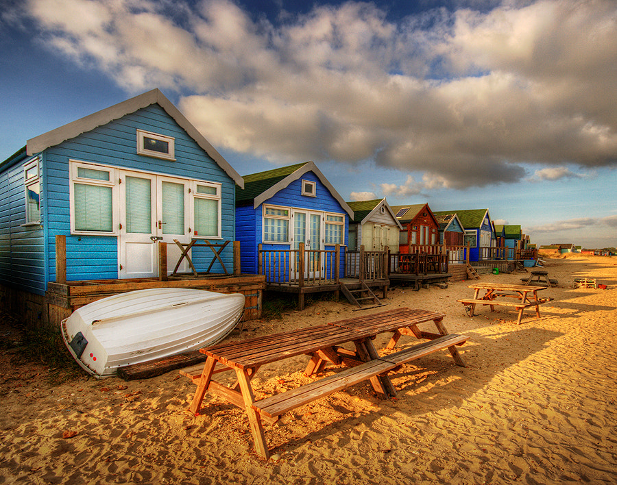 Photograph Beach Huts and a Boat by Martin Wait on 500px