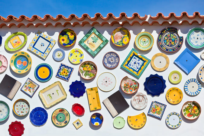 Traditional portuguese pottery plates on a wall in Algarve by Heather Balmain on 500px