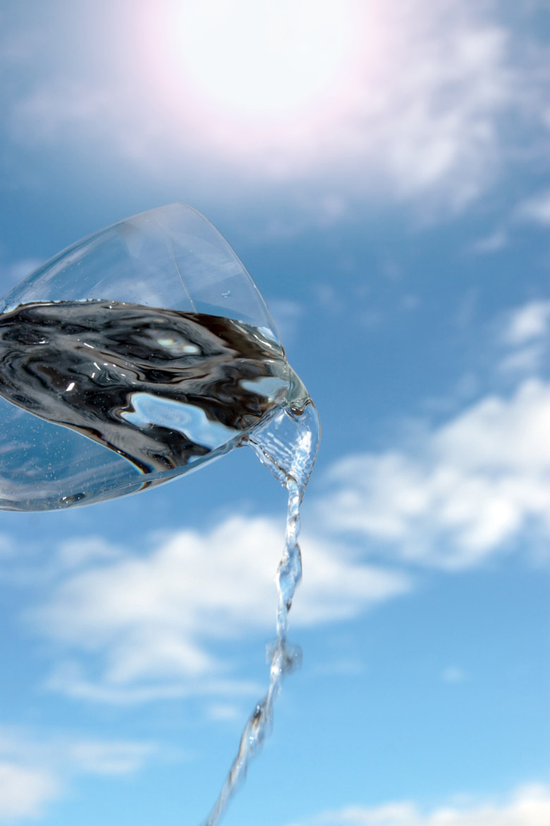 Photograph glass of water against a sunny sky by David Morrison on 500px