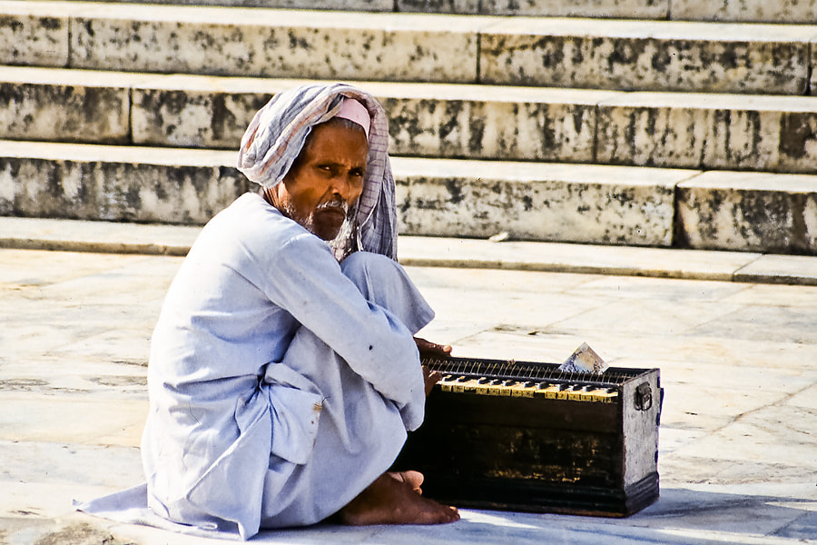 Photograph Indian man and his organ by Christer Häggqvist on 500px