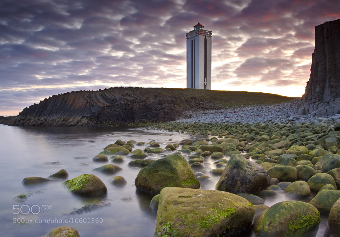 Photograph The Light house and the Columnar basalt by Jon Hilmarsson on 500px