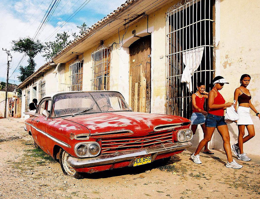 Red car and girls, Trinidad - Cuba