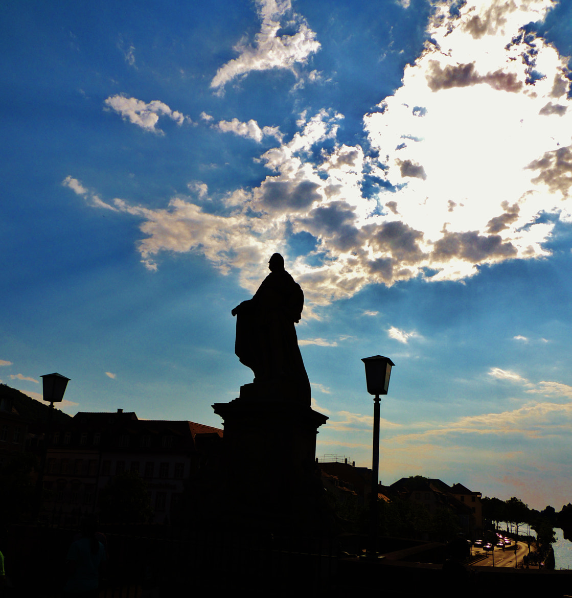 Photograph Silhouette of a statue and the evening sun. by Ravi S R on 500px