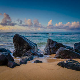 Rocks on Poipu Beach at sunrise, Kauai, Hawaii