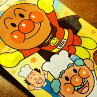 Anpanman (アンパンマン) and friends on a candy packing background