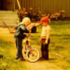 Little Juga inspecting a bicycle