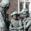 A statue of Mr Topelius with children