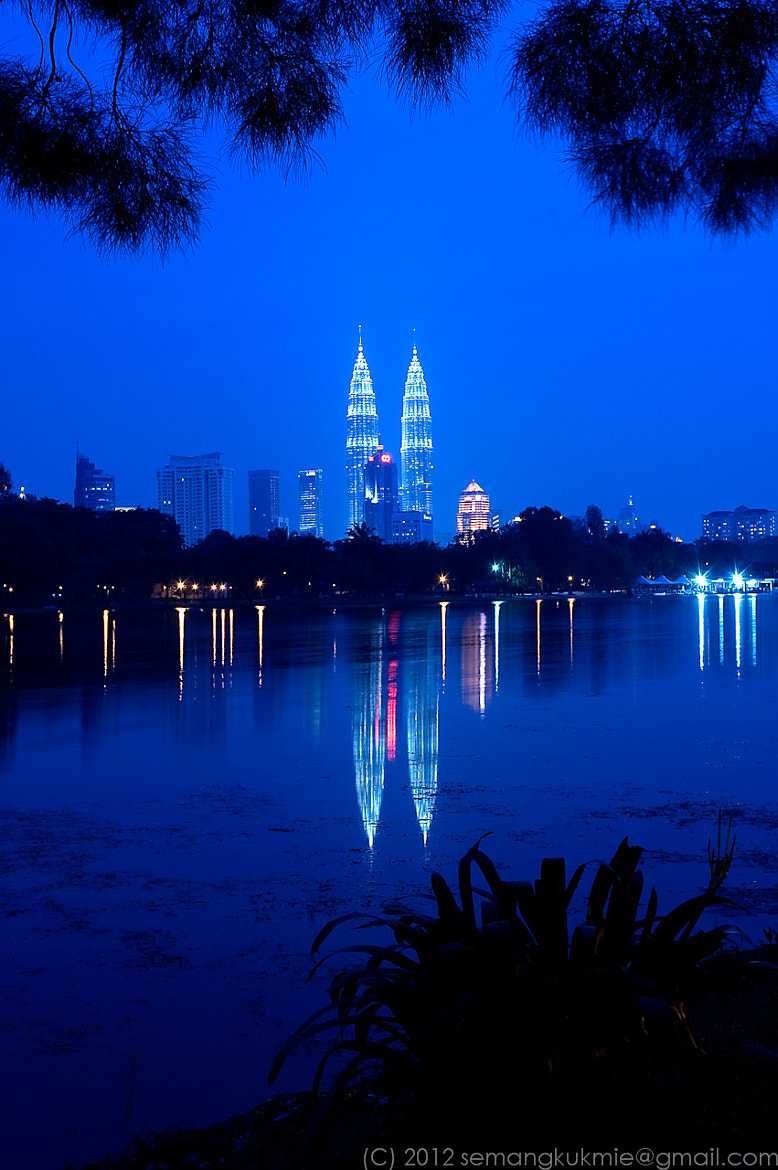 Photograph Petronas Twin towers reflection by Ricky S on 500px