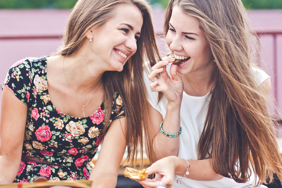 Laughing girls eat chocolate by Vadim Martynenko on 500px.com