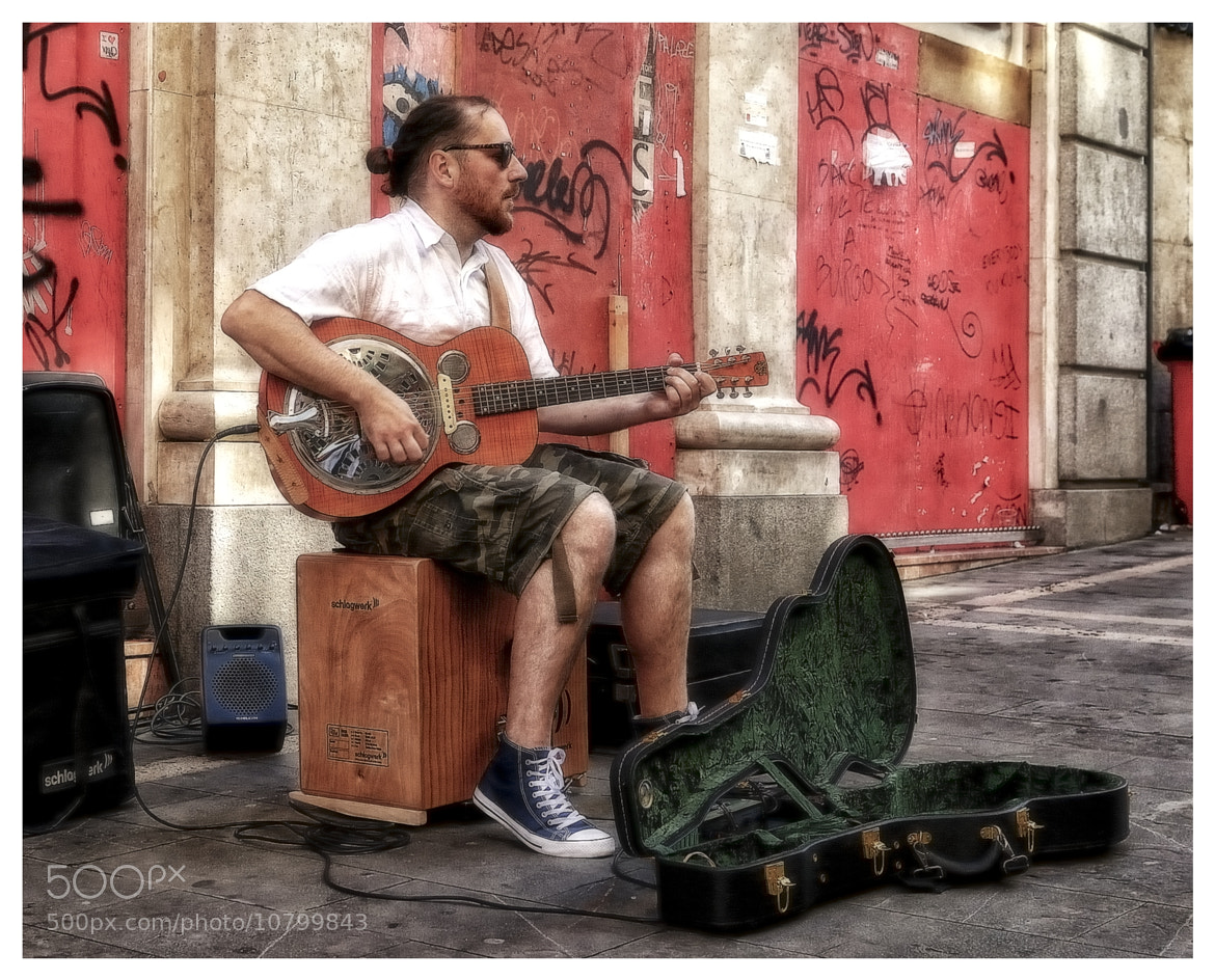 Photograph Street guitarist by Julio Sanchez on 500px