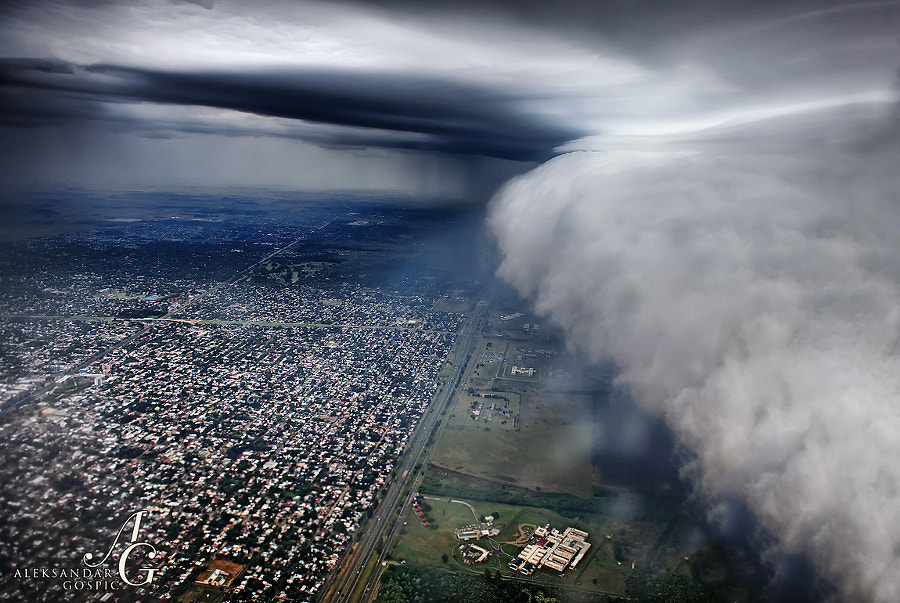 Landing in Buenos Aires during the storm. Only 100m above the ground, during the first approach to the runway of Ezeiza airport, captain had to abort the landing because we were in the middle of the storm, hit the gas and flew up again. Few moments later we shoot out of this amazing shelf cloud, whose cumulonimbus already swallowed the airport. Second landing was successful.