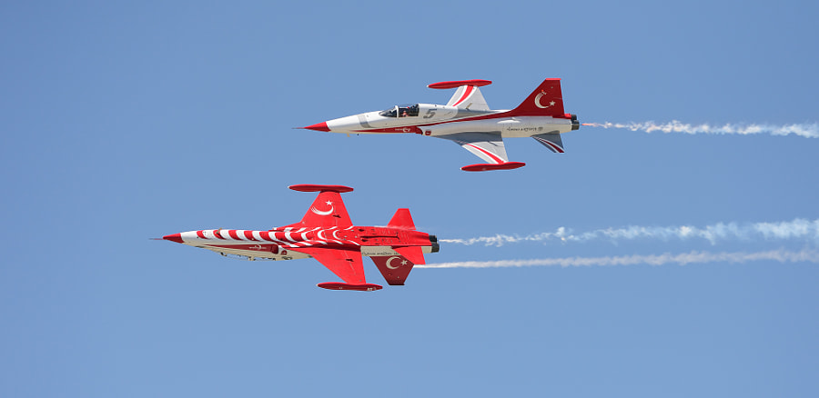 """Two of the Turkish Stars, the Aerobatic Team of the Turkish Air Force in their Canadair NF-5s aircraft.  On top you'll  see plane number 5 with First Lieutenant Hasan Kocabaş at the joystick and below him in plane number 4 it is Major Şenol ÇETİN which controlled the plane.  Shot taken last week during the NATO Tiger Meet 2015 on Konya Air Base in Turkey.  ©<a href=""""http://www.hewaph.com"""">Harry Eggens</a>  Wishing you all a great weekend,  Harry"""