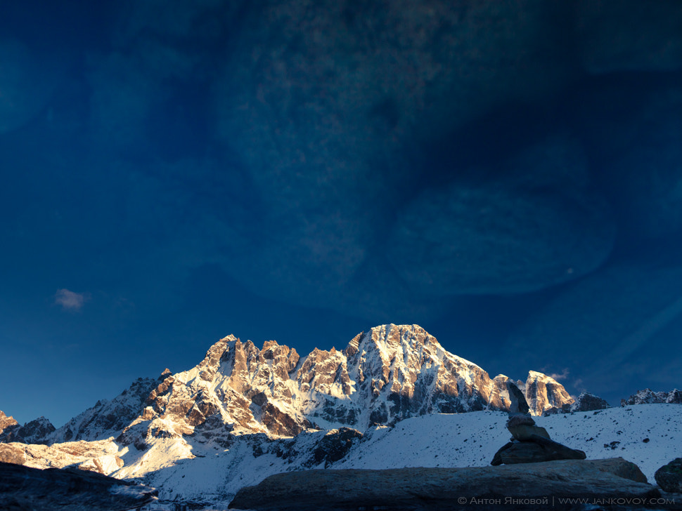 Photograph Reflection of the Pharilapche peak (6,073 m) in the Gokyo lake (4,075 m) by Anton Jankovoy on 500px