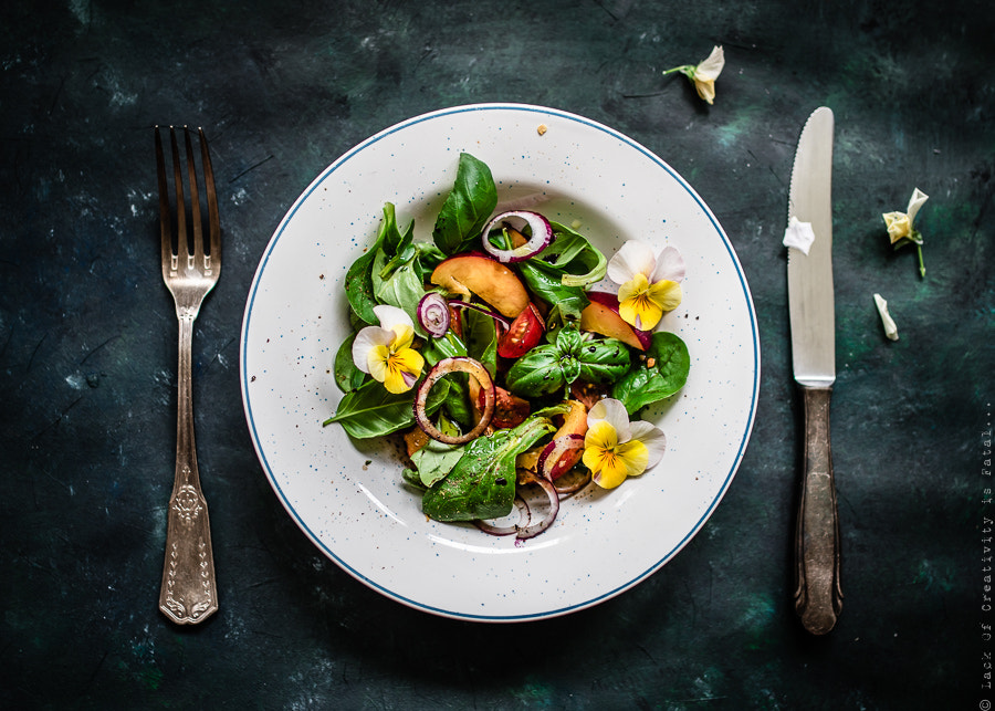 Photograph Colorful summer salad with nectarines and edible flowers. by crazy cake on 500px