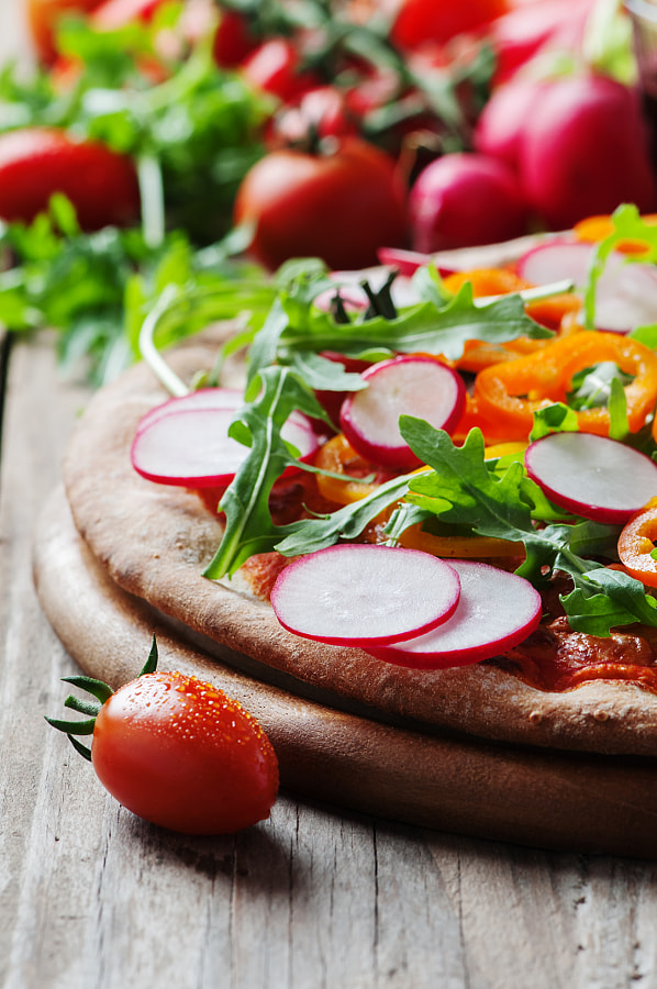 Vegan pizza with radish, tomato and paprika by Oxana Denezhkina on 500px.com