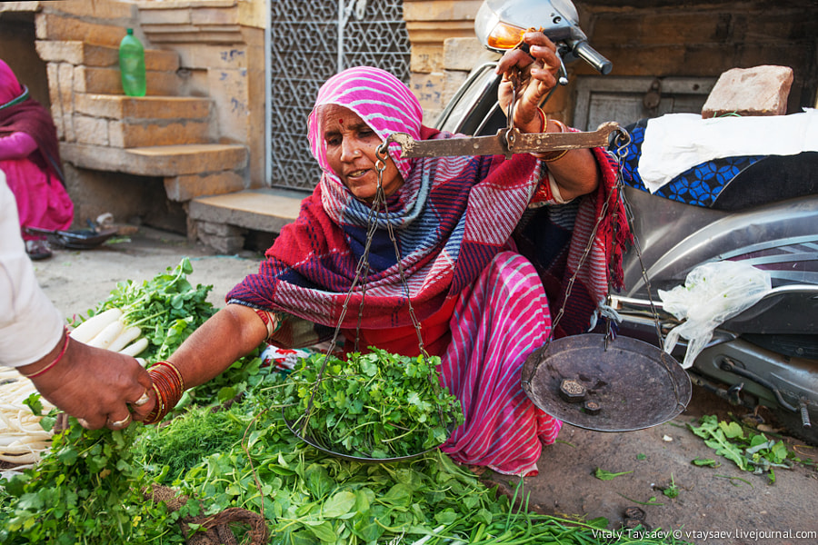 Photograph Indian woman on street market by Vitaly Taysaev on 500px