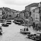 A bunch of boats in busy Venice