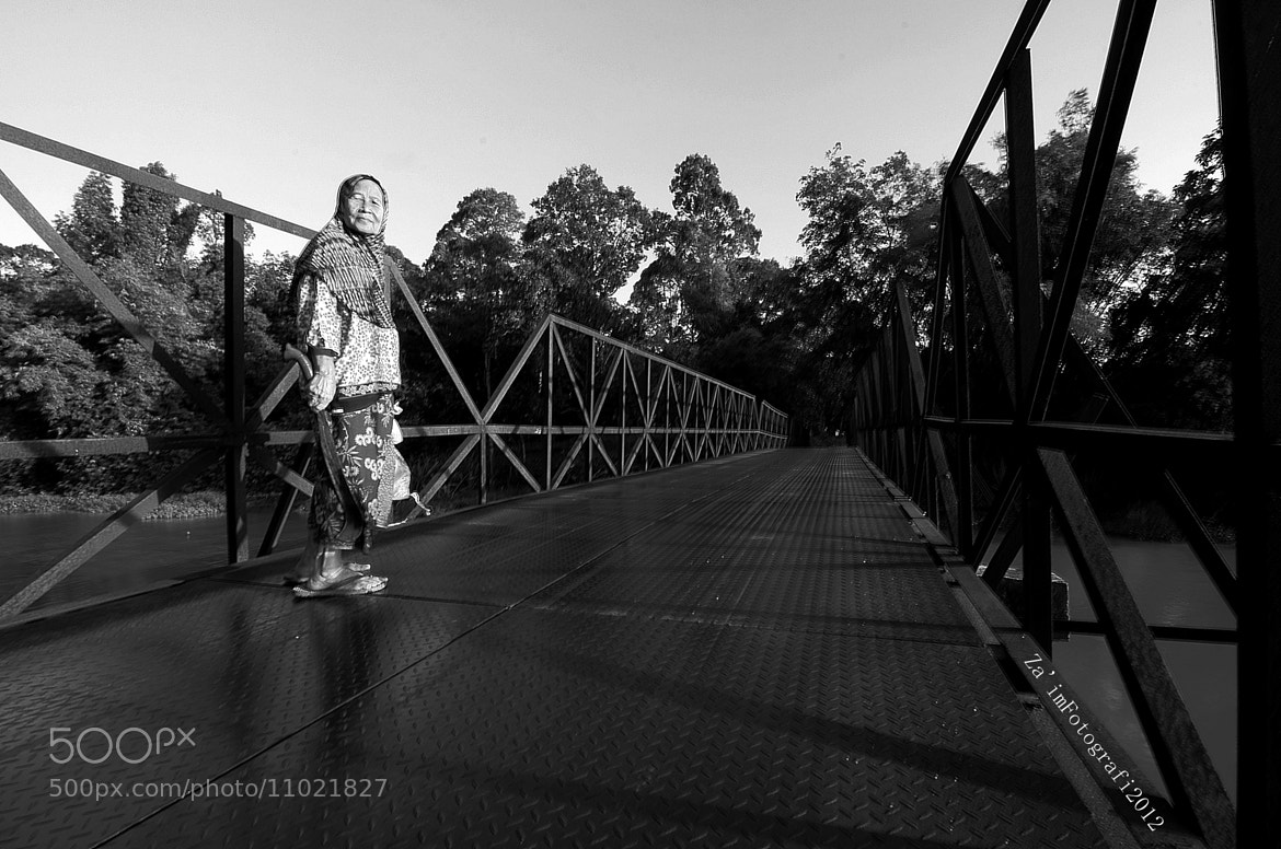 Photograph An Old Women on an old bridge by Za'im Hassan on 500px