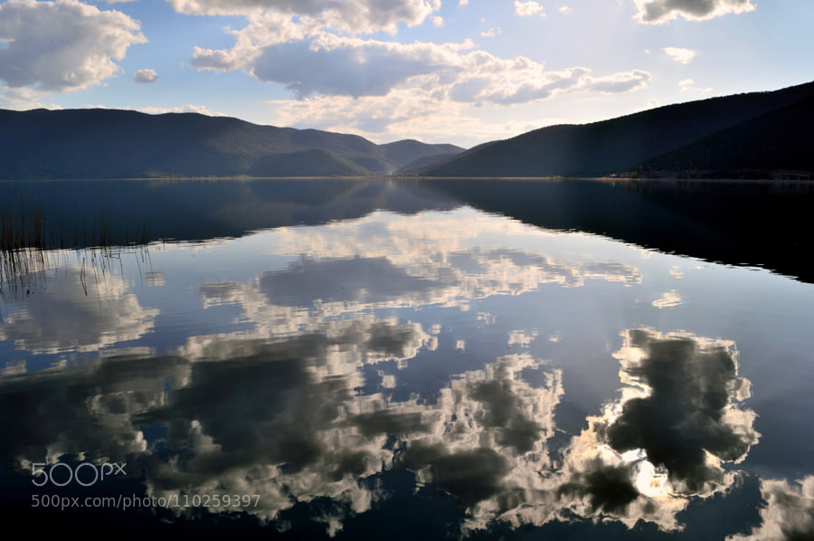 Photograph Cloud reflections before sunset by Papanikolaou Joanna on 500px