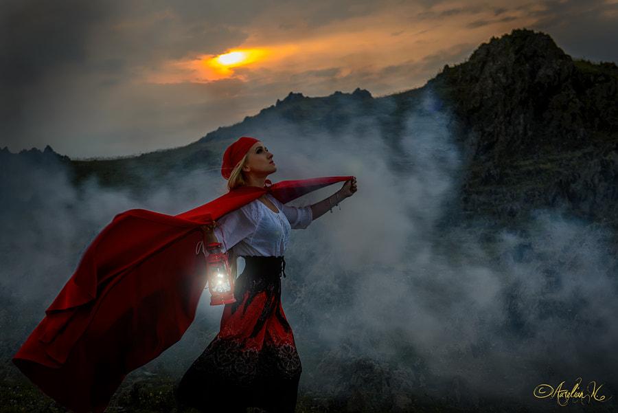 Adventurous girl with lantern in sunset