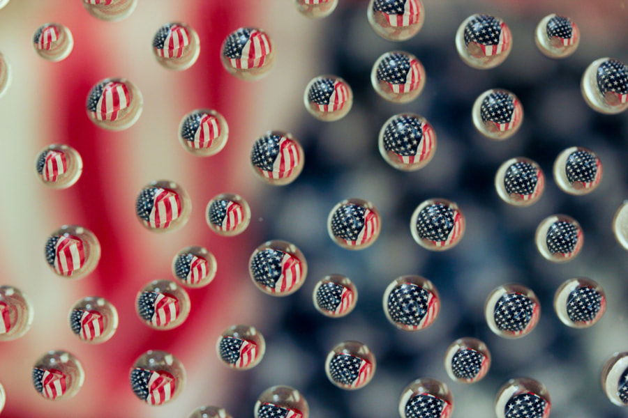 Flag reflections on drops of water.
