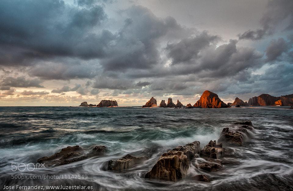 Photograph Atardecer en Gueirua con Manuel Daneri. Sunset in Gueirua Beach with Manuel Daneri by Jose Fernandez on 500px