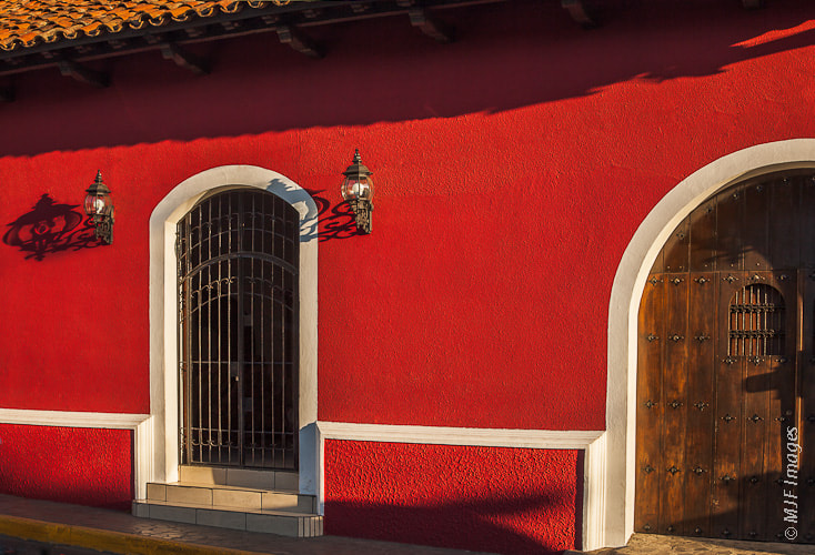 Photograph Leon Red Building by Michael Flaherty on 500px