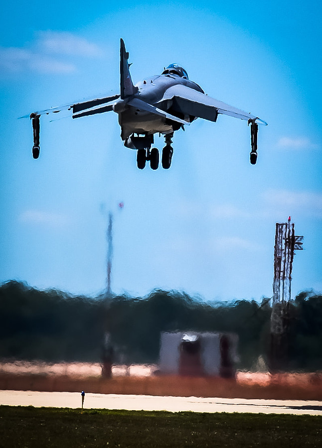 The only privately-owned Sea Harrier in the world (owned and flown by Art Nalls) makes a vertical landing at Thunder Over Michigan, Willow Run Airport, Ypsilanti, Michigan