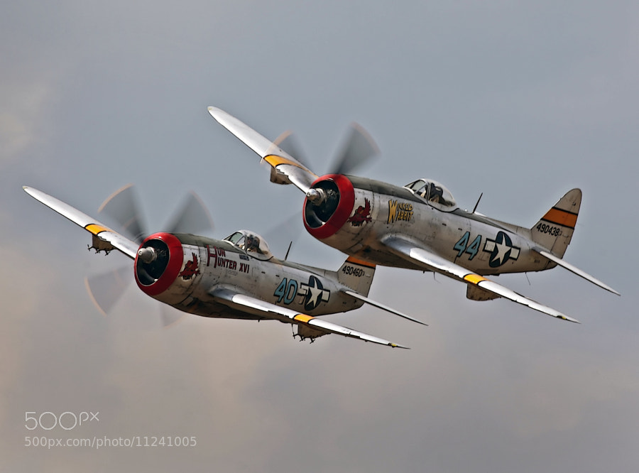 This two ship formation of P-47D, Thunderbolts, AKA, Jug, was photographed at the 2012 Thunder Over Michigan Air Show, 4 August 2012.