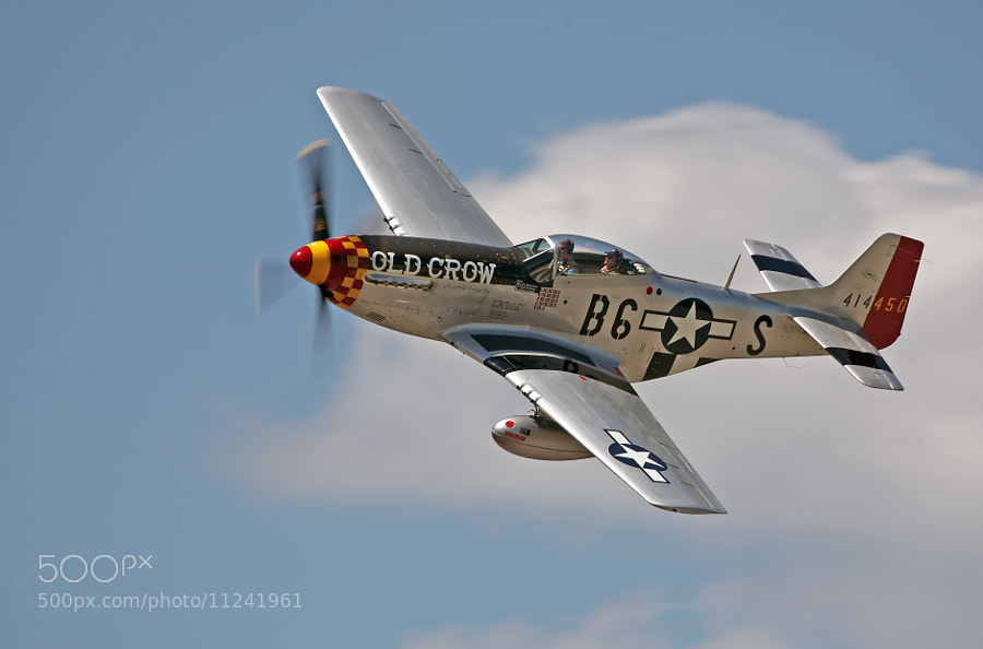 P-51D Mustang 'Old Crow'  in flight over Thunder Over Michigan 2012.  This Mustang is in the markings of 'triple ace' Clarence 'Bud' Anderseon.