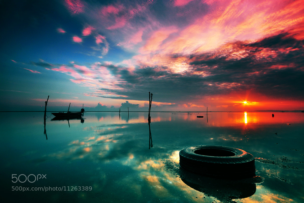 Photograph The Old Tyre in the Sunrise by Razali Ahmad on 500px