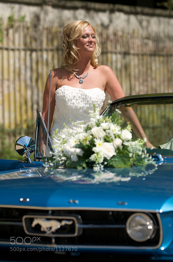 Bride next to Ford Mustang