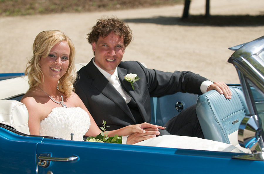 "Bride and groom in Ford Mustang at ""Groot Warnsborn"", Arnhem (Gelderland, Netherlands)"