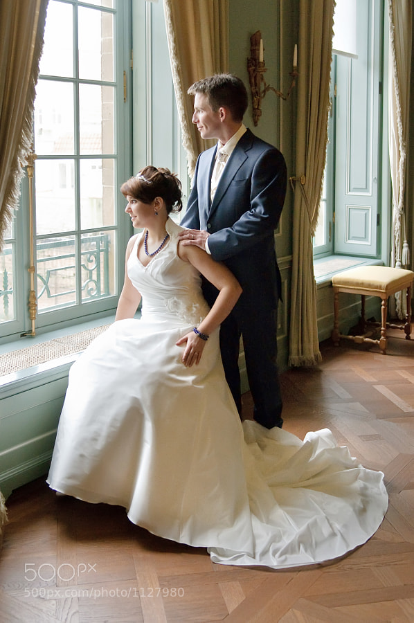 Bride and groom at a window