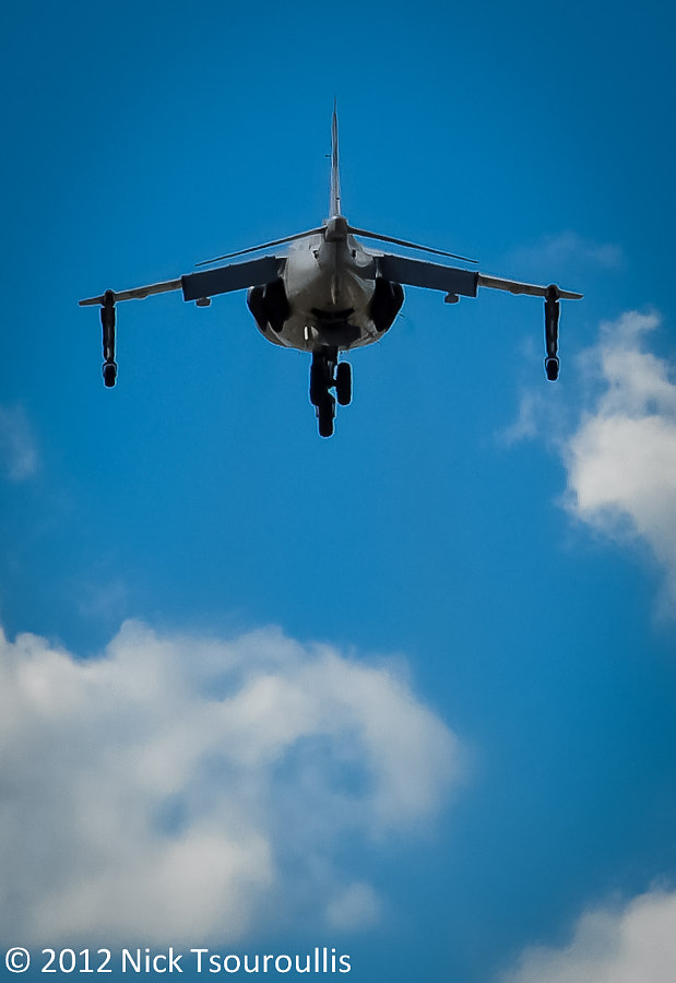 Sea Harrier hovers over crowd at airshow
