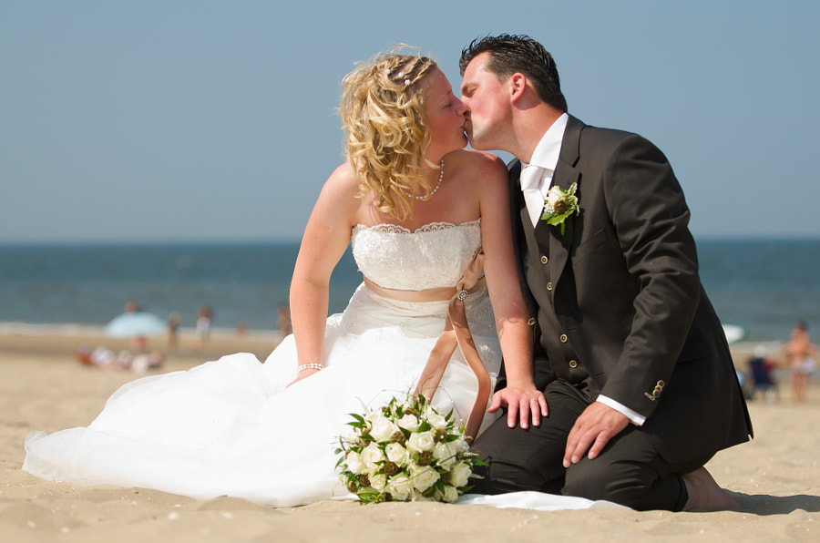 Bride and groom: Passion at the beach in Noordwijk (Netherlands)