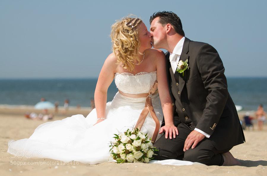 Bride and groom: Passion at the beach in Noordwijk (Netherlands)
